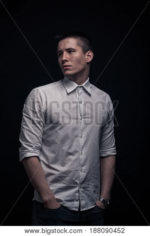 One Young Man, Portrait, Sideways Glance, Hands In Pockets, Black Background
