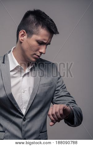 One Young Man, Upper Body, Formal Clothes, Looking To Watch