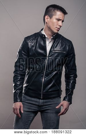 Young Man, Looking Tense Sideways, Leather Jacket,