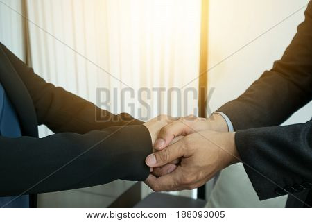 businessman and businesswoman check hand when success.