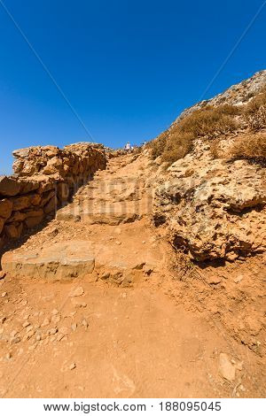 The mountain path for the descent from the top plateau to Balos beach. Crete. Greece.