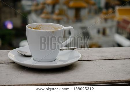 Hot art Latte Coffee in a cup on wooden table and blur background with