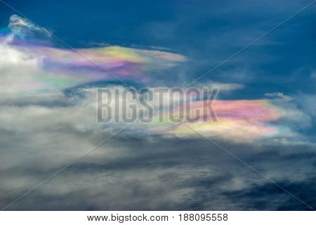 Blue sky with beautiful rainbow color cloud