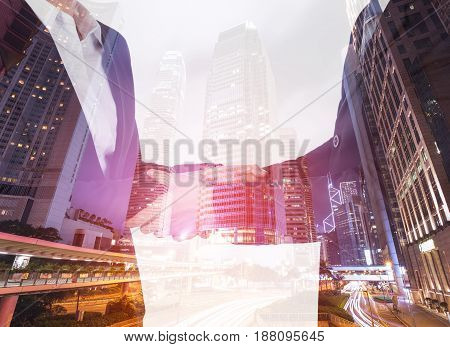 Double Exposure Of Shaking Hand Between Businessman And Businesswoman With City Background