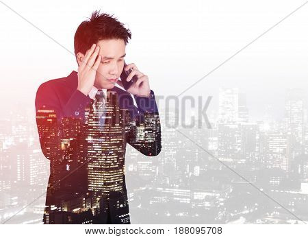 Double Exposure Of Worried Businessman Talking On Smartphone With City Background