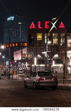 BERLIN - MARCH 05 2016: Shopping center Alexa on Alexanderplatz in the evening illumination. Alexa is the second largest (56.200 square meters) shopping center in Berlin.
