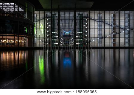 BERLIN - MARCH 05 2016: The complex of buildings in the government quarter (Regierungsviertel). Paul-Loebe-Haus and Spree river at night.