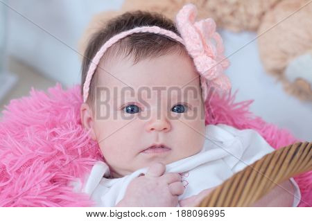 baby girl newborn portrait in pink blanket lying in basket cute face card composition new life