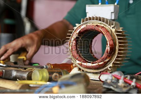 repairman during maintenance work of electric motors