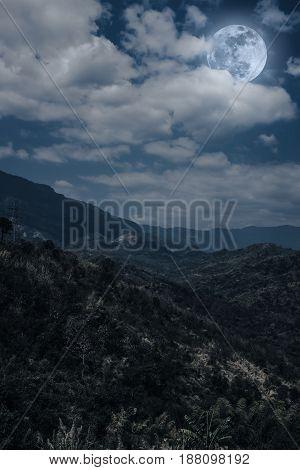 Beautiful Landscape Of Blue Dark Night Sky And Cloudy Above Mountain Peak.