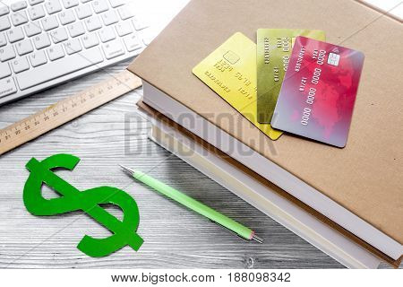 online pay for fee-paying education on gray wooden student desk background