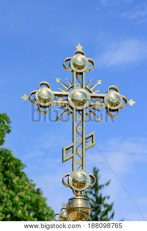 Golden Orthodox Christian cross on the background of the blue sky of the Kiev Pechersk Lavra