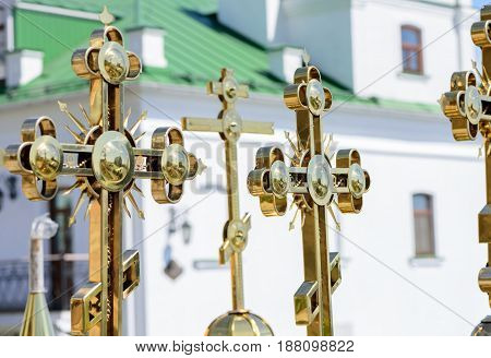 Golden Orthodox Christian crosses on the domes of the churches of Kiev's Pechersk Lavra