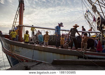 PRACHUAP KHIRI KHAN THAILAND - MARCH 29 2017 : worker on thai fishery boat approaching for located fresh fish to fishing port of klong wan after seeking over last night in prachaup khiri khan southern of thailand