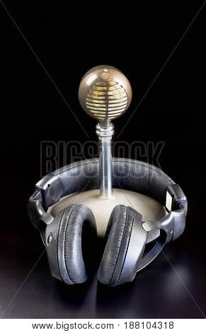 Old school microphone and headphones with room for your type.