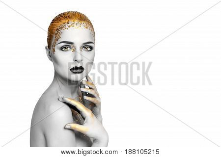 Beauty woman portrait. Beautiful model girl with perfect fresh clean skin and dark golden professional makeup. Blonde female on white background. Creative fantasy evening gold make-up. Space for text.