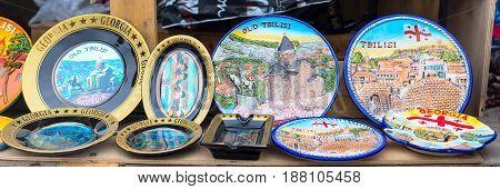 Mtskheta, Georgia - April 28, 2017: Georgian gift souvenir plates in the shop
