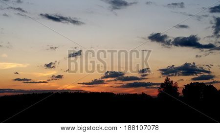 Shot of a landscape with a beautifull red blue and orange toned sky.