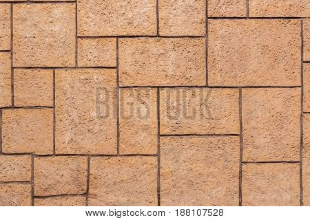 Brown brick wall of different sizes. Front view