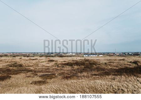 Denmark landscape with some houses in the distance