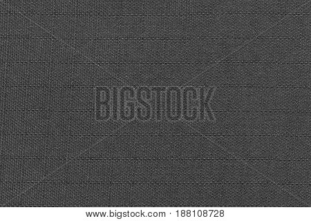 Dark gray fabric woven in square shape. Top view