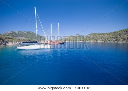 Boats anchored at a bay in the Turkish Mediterranean. Wide angle composition. poster