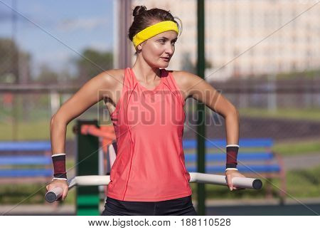 Sport Ideas. Caucaasian Professional Female Athlete In Outfit Having Fitness Workout Training Outdoor.Horizontal Image
