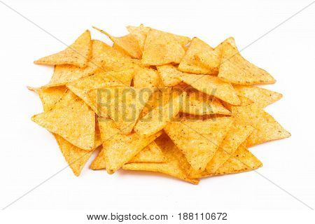 front view of nachos chips on top of each other isolated on white background