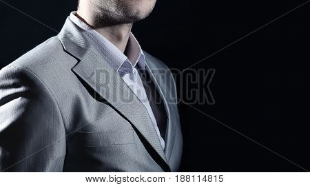 Man in business suit business man on black background
