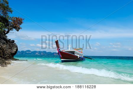 longtail boats on the beach in thailand Andaman Sea