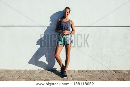 Healthy Female Relaxing After Running Exercise