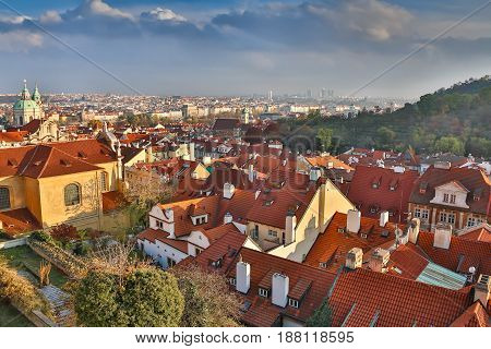 Aerial view over Church of Our Lady before Tyn, Old Town and Prague Castle at sunset in Prague, Czech Republic.