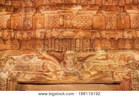 Patterns and figurs of myth creations inside the 7th century Durga temple, medieval era Hindu temple in Aihole, India. Ancient Indian artwork