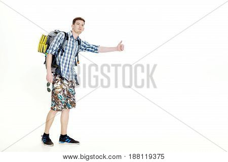 Travel man hitchhiking. young male hitchhiker on the white background
