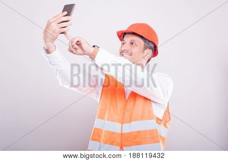 Foreman Wearing Reflective Vest Making Selfie
