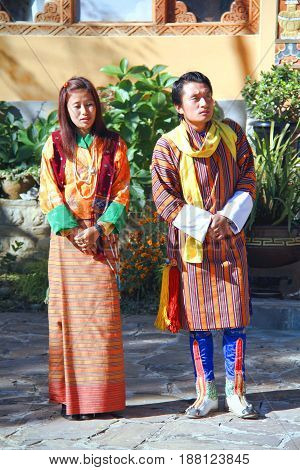 PARO BHUTAN - November 10 2012 : Unidentified couple of young dancers in colorful Bhutanese traditional cloths at Tiger Nest Resort Paro Bhutan