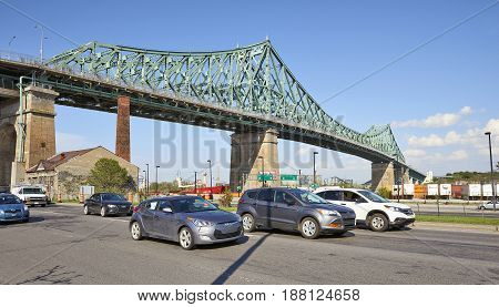 Traffic On Street Under The Jacques Cartier Bridge