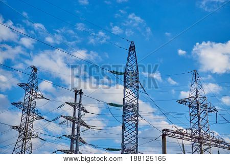 High voltage post tower sky background with clouds