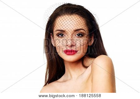 portrait of young beautiful woman wearing black veil isolated on white