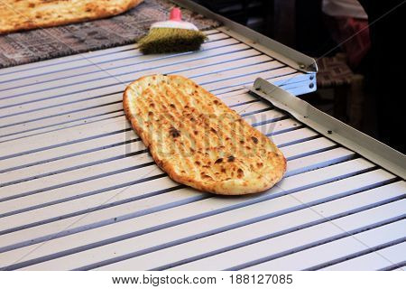 Freshly baked flatbread, hot out of the oven