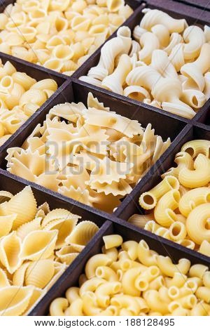 pasta assortment background. Pasta in a wooden box. Italian pasta of different colors