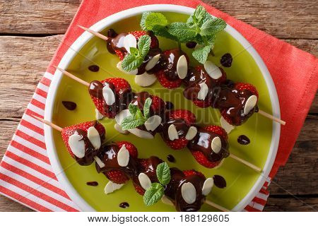 Summer Strawberries Dessert With Chocolate, Mint And Almonds. Horizontal Top View
