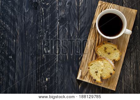 Morning concept. Coffee and scone on wooden background