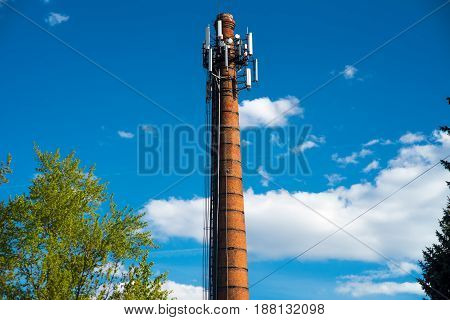 Industrial Old Brick Chimney without smoke, on blue sky