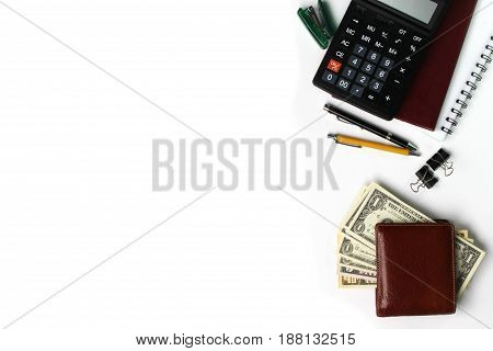 White office desk with copy space pen wallet and supplies. Top view with copy space.