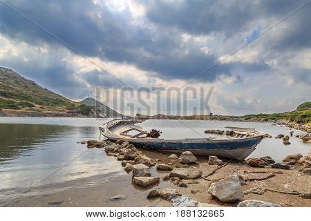 Shipwreck in knidos beach with lighthouse in the back