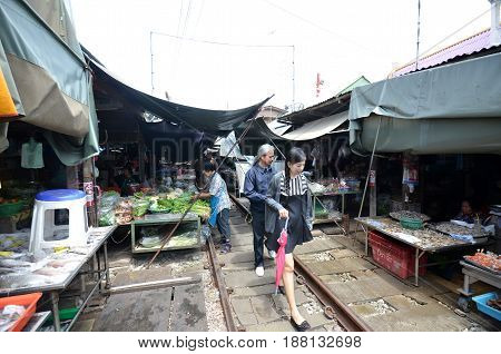 Vendors Sell Food At Mae Klong Railway Tracks Market