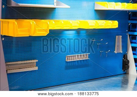 blue and yellow tool board background. Empty tool wall