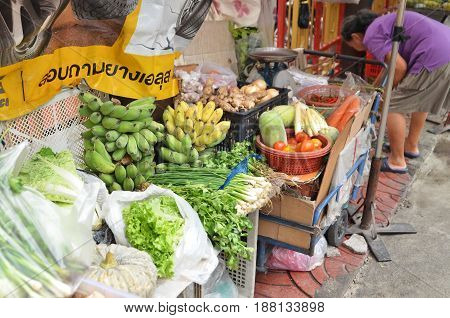 Vendor Sells Fresh Local Agricultural Production