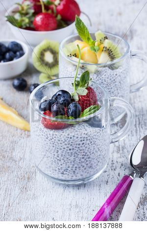 chia seed pudding with fresh fruits on a white background